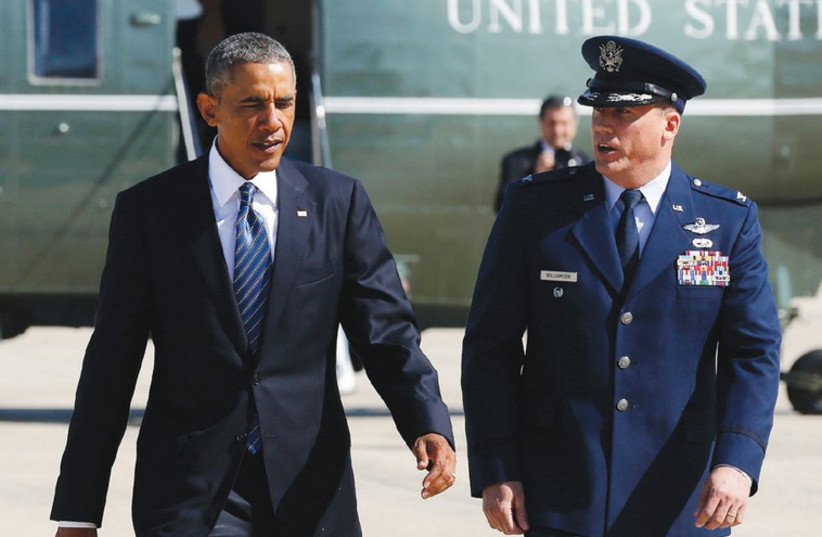 US PRESIDENT Barack Obama, accompanied by US Air Force Col. Preston Williamson IV, prepares to depart Andrews Air Force Base outside Washington. (photo credit: REUTERS)
