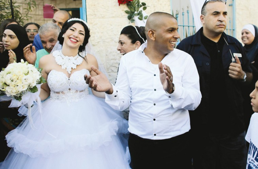 Bride Morel Malka, 23 and her groom Mahmoud Mansour, 26, celebrate with friends and family before their wedding on August 17. (photo credit: REUTERS)
