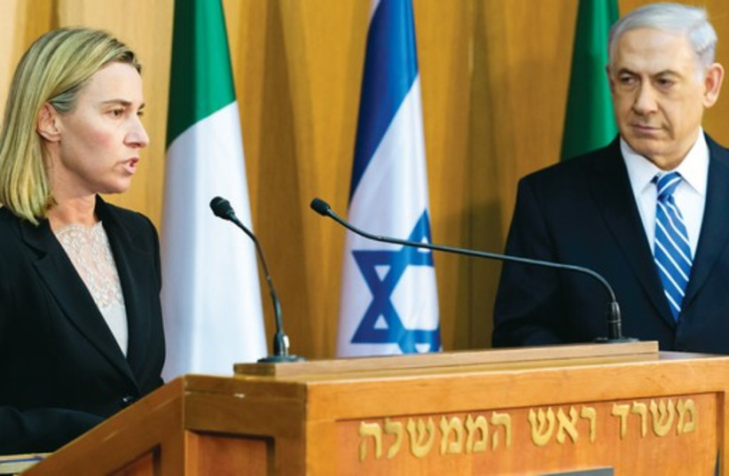 Italy's foreign Minister Federica Mogherini speaks as she delivers a joint statement with Prime Minister Binyamin Netanyahu during their meeting in Jerusalem on July 16. (photo credit: REUTERS)