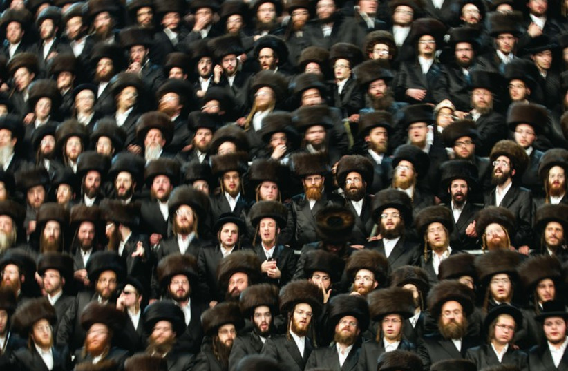 Ultra orthodox Jews wear shtreimels to a traditional religious wedding ceremony in Jerusalem. (photo credit: REUTERS)