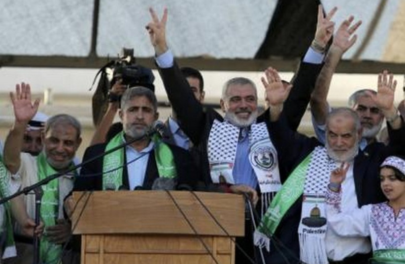 Hamas Gaza leader Ismail Haniyeh celebrates in Gaza what they say was a victory over Israel, in Gaza City August 27  (photo credit: REUTERS)