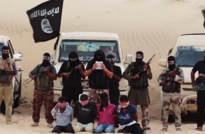 Screenshot of Ansar Bayit al-Maqdis terrorists decapitating alleged Mossad spies (photo credit: screenshot)