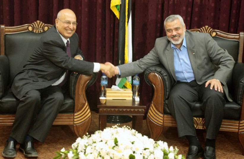 Fatah official Nabil Shaath (L) and Hamas deputy political bureau chief Ismail Haniyeh. (photo credit: REUTERS)