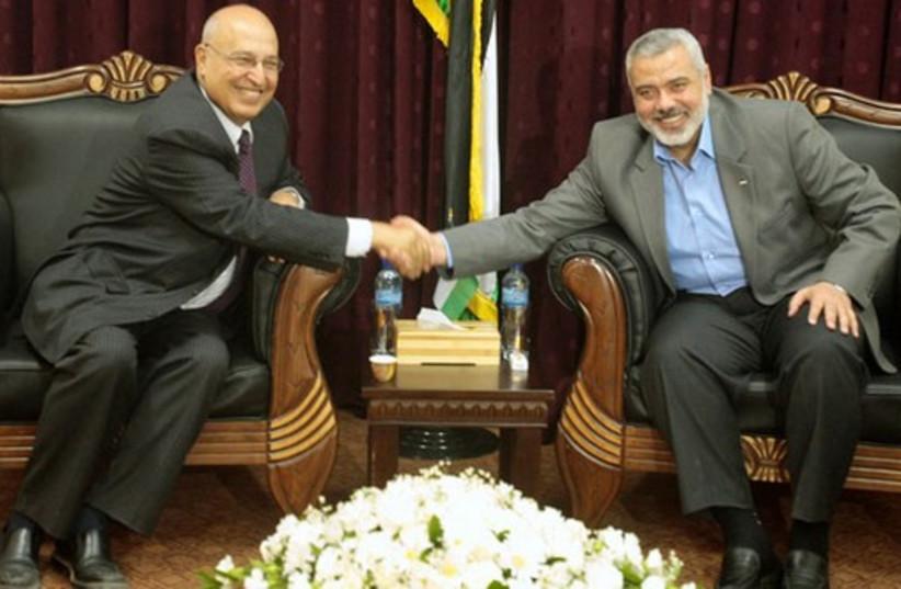 Fatah official Nabil Shaath (L) and Hamas deputy political bureau chief Ismail Haniyeh. (photo credit: REUTERS)