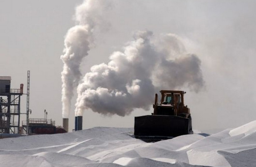 A bulldozer works at a magnesium factory near the Dead Sea.  (photo credit: REUTERS)