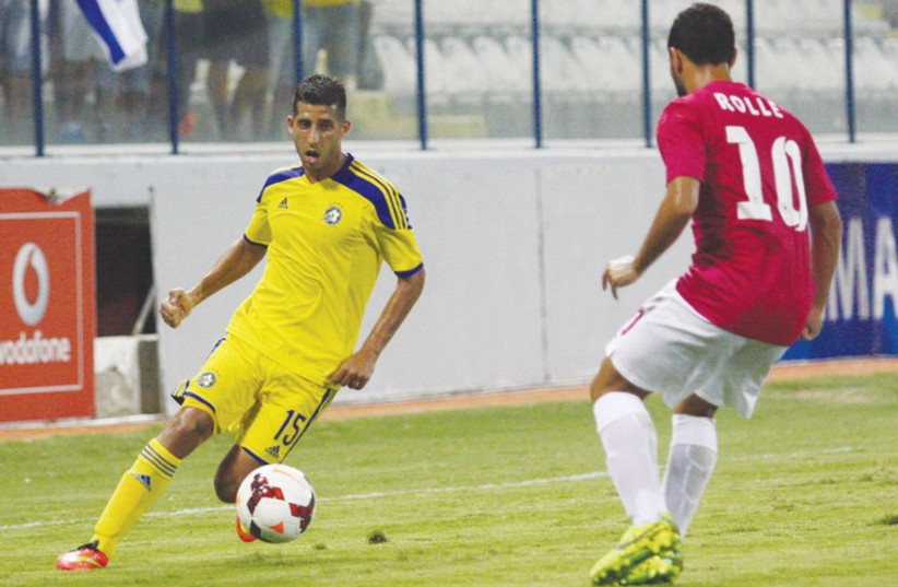 Maccabi Tel Aviv midfielder Dor Micha (left) and his teammates did their best, but Martin Rolle and Asteras held on to advance to the Europa League group stage on away goals. (photo credit: MACCABI TEL AVIV WEBSITE)