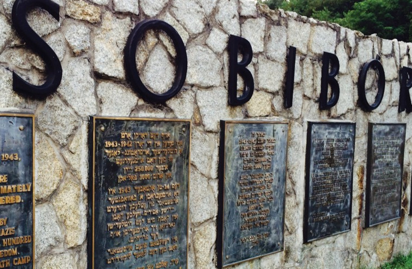 A SIGN marks the site of the Sobibor death camp, obliterated by the Nazis to hide their crimes after the prisoners' revolt in 1943. (photo credit: FROM THE DEPTHS)