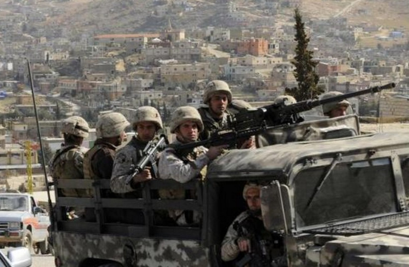 Lebanese army soldiers patrol on their armoured vehicle the Sunni Muslim border town of Arsal. (photo credit: REUTERS)