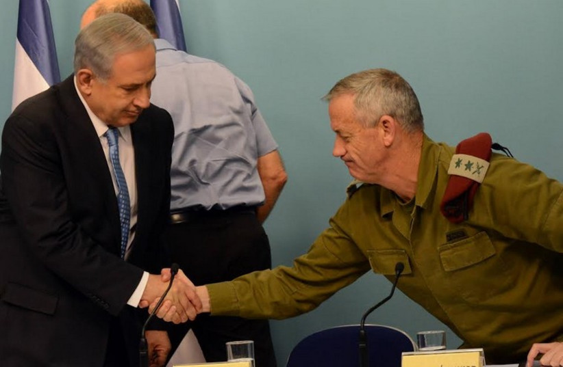 Prime Minister Benjamin Netanyahu (L) shakes hands with then-IDF chief of staff Benny Gantz during the 2014 Gaza conflict. (photo credit: HAIM ZACH/GPO)
