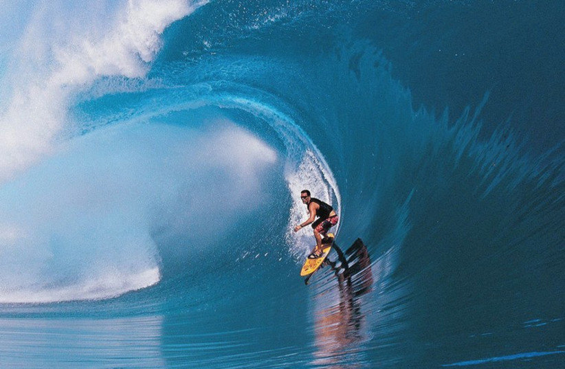 MAKING WAVES: American big-wave surfer Laird Hamilton in a scene from 'Riding Giants.' (photo credit: COLLIDER.COM)