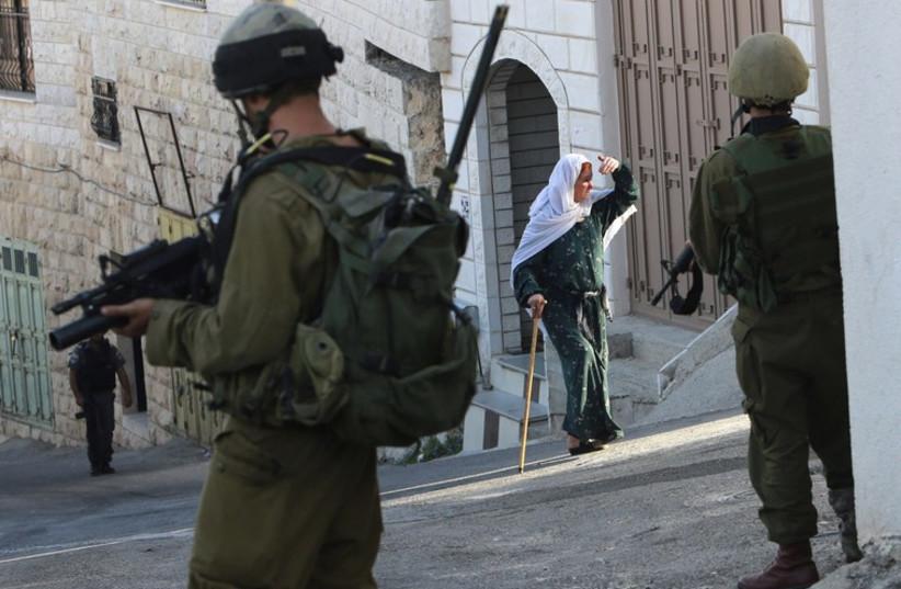 IDF soldiers patrol in Nablus [file] (photo credit: REUTERS)