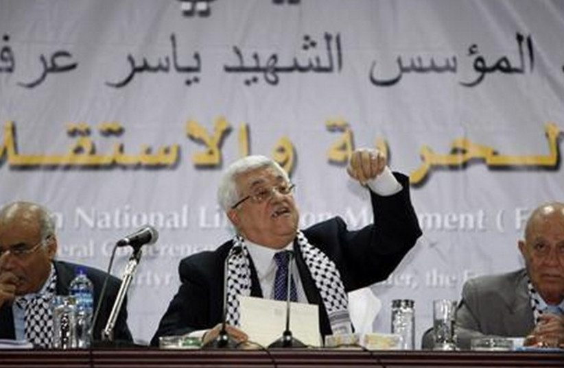 Palestinian Authority President Mahmoud Abbas speaks at a Fatah conference in Ramallah in 2009. (photo credit: REUTERS)