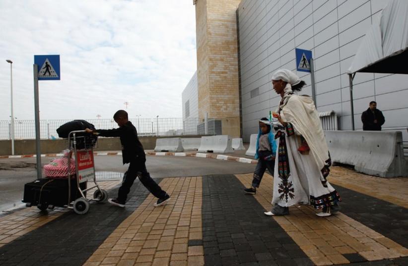 Ethiopian Jewish immigrants leave Ben-Gurion Airport in 2011. (photo credit: REUTERS)