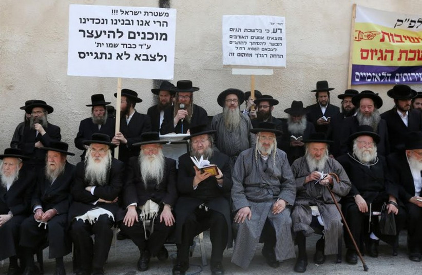 Ultra-Orthodox Jews protest the arrest of a yeshiva student who refused to be drafted. (photo credit: MARC ISRAEL SELLEM)