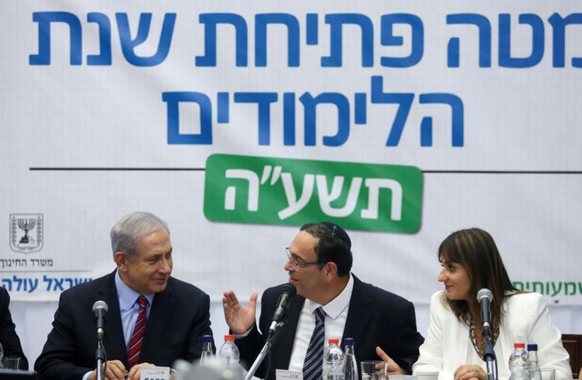 Prime Minister Binyamin Netanyahu, then-Education Minister Shay Piron, and Education Ministry director-general Michal Cohen in 2014 (photo credit: MARC ISRAEL SELLEM)