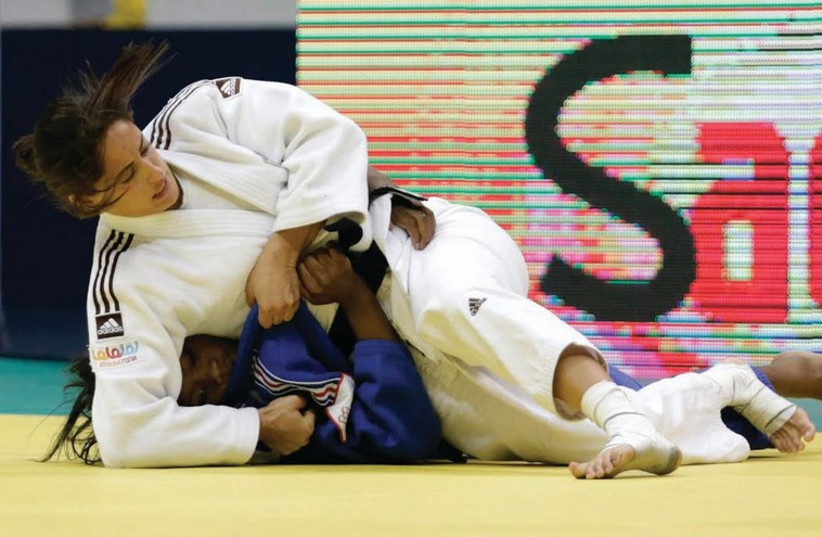 Yarden Gerbi received a hero's welcome at Ben-Gurion Airport August 31 after winning silver medal at World Judo Championships in Russia (photo credit: REUTERS)