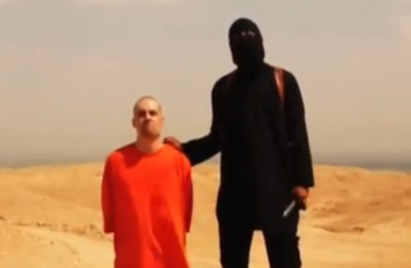 Islamic State terrorist and James Foley (photo credit: YOUTUBE SCREENSHOT)