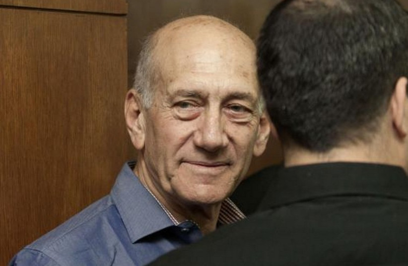 Former Israeli Prime Minister Ehud Olmert waits to hear his verdict at the Tel Aviv District Court, March 31, 2014. (photo credit: REUTERS)