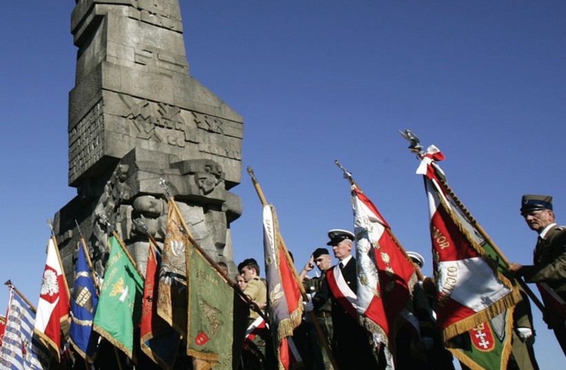 A Polish guard of honor during ceremony September 1 in front of the Westerplatte monument erected where first shots of World War II were fired on September 1, 1939 (photo credit: REUTERS)