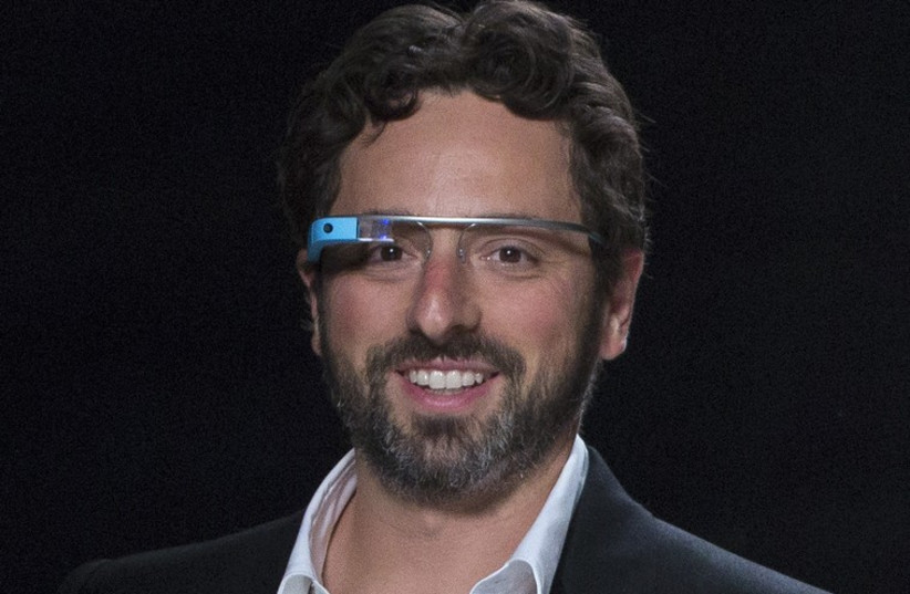 """Google co-founder Sergey Brin walks the runway wearing new product """"Glass by Google"""". (photo credit: REUTERS)"""