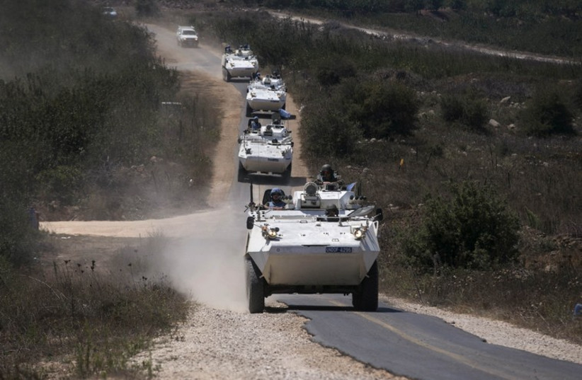 UN Disengagement Observer Force (UNDOF) troops move through Israel's Golan Heights before crossing into Syria, August 31. (photo credit: REUTERS/BAZ RATNER)