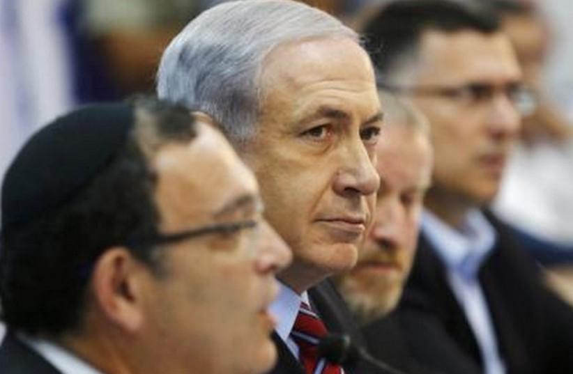 Prime Minister Benjamin Netanyahu attends a special cabinet meeting at the Ashkelon Coast Regional Council August 31, 2014. (photo credit: REUTERS)