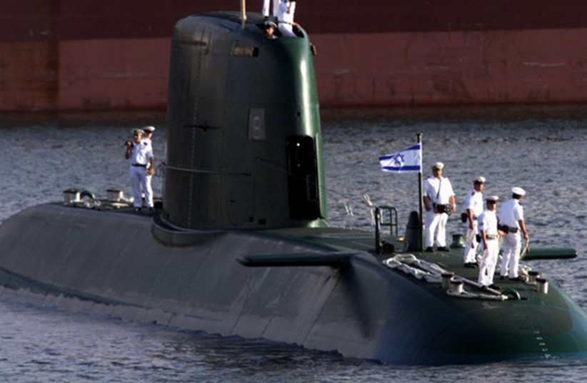 A Dolphin-class submarine enters Haifa port. (photo credit: REUTERS)