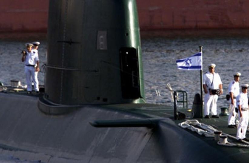 A Dolphin-class submarine enters Haifa port. (photo credit: REUTERS)