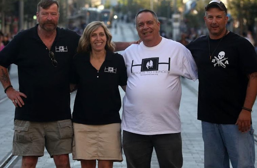 HEROES TO HEROES founder Judy I. Schaffer poses with (from left) US military veteran Cliff Nolan, IDF veteran Zvika Comay, and US veteran Gregory Cruz, in Jerusalem (photo credit: MARC ISRAEL SELLEM/THE JERUSALEM POST)