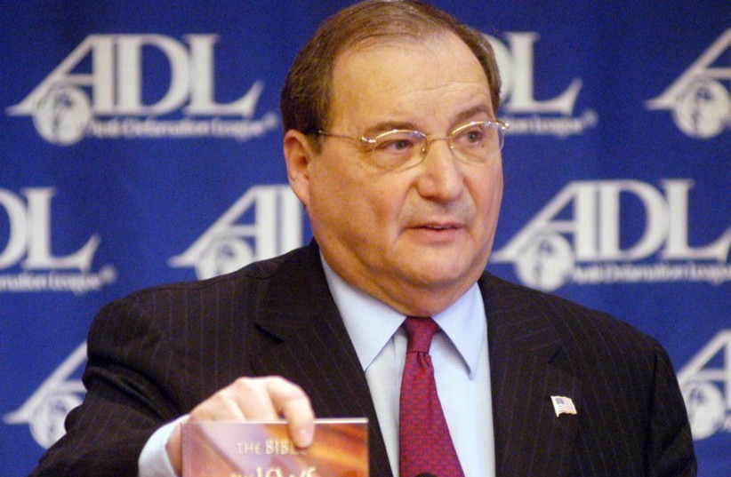 """Abraham H. Foxman, National Director of the Anti-Defamation League, shows the book """"The Bible, the Jews, and the Death of Jesus""""  (photo credit: REUTERS)"""