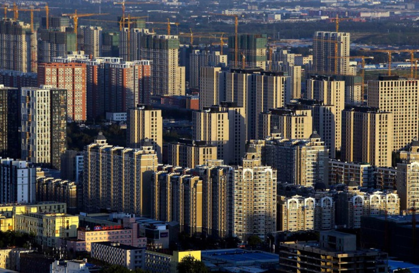 Buildings are seen at sunset in Beijing (photo credit: REUTERS)