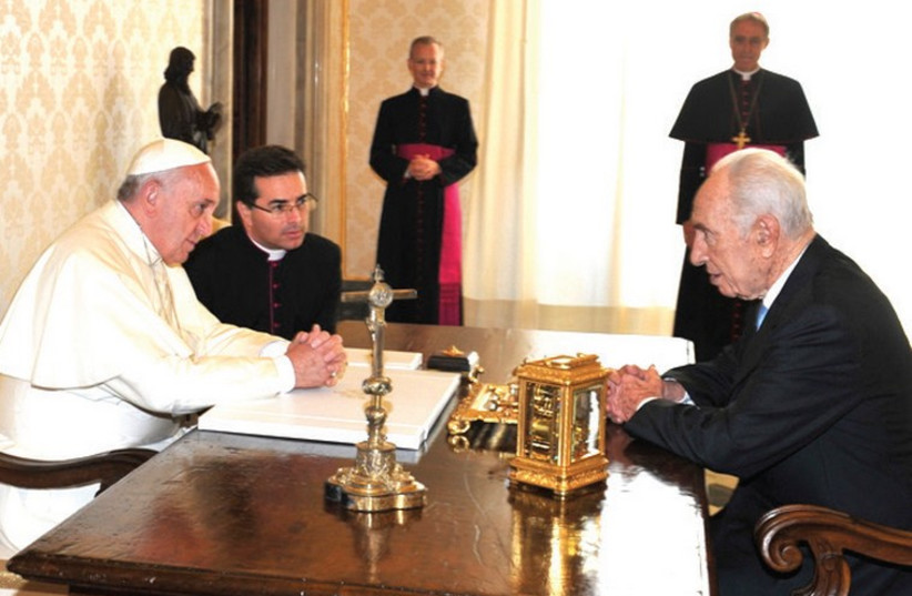 POPE FRANCIS and former president Shimon Peres chat at the Vatican (photo credit: Courtesy)