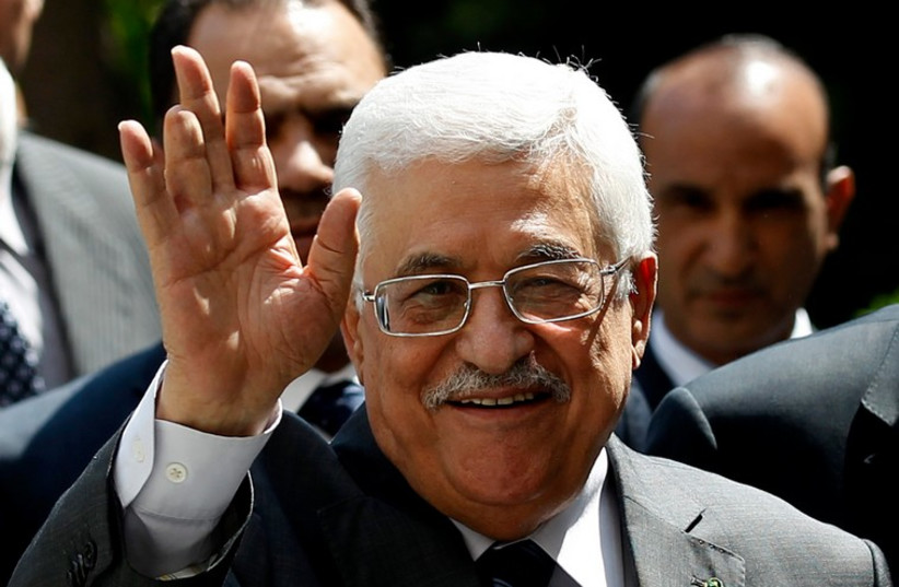Palestinian Authority President Mahmoud Abbas arrives for an Arab League Foreign Ministers emergency meeting at the league's headquarters in Cairo (photo credit: REUTERS)
