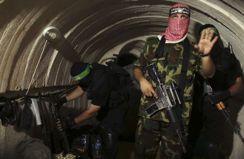 Hamas terror operatives in Gaza tunnel (photo credit: REUTERS)