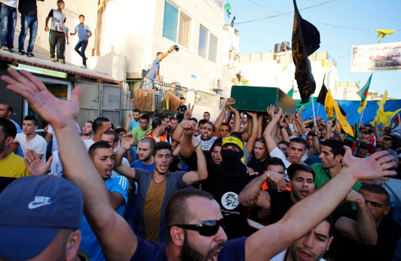 Palestinians carry the coffin of Muhammad Sunuqrut during his funeral in East Jerusalem's Wadi Joz neighbourhood, September 8 (photo credit: REUTERS)