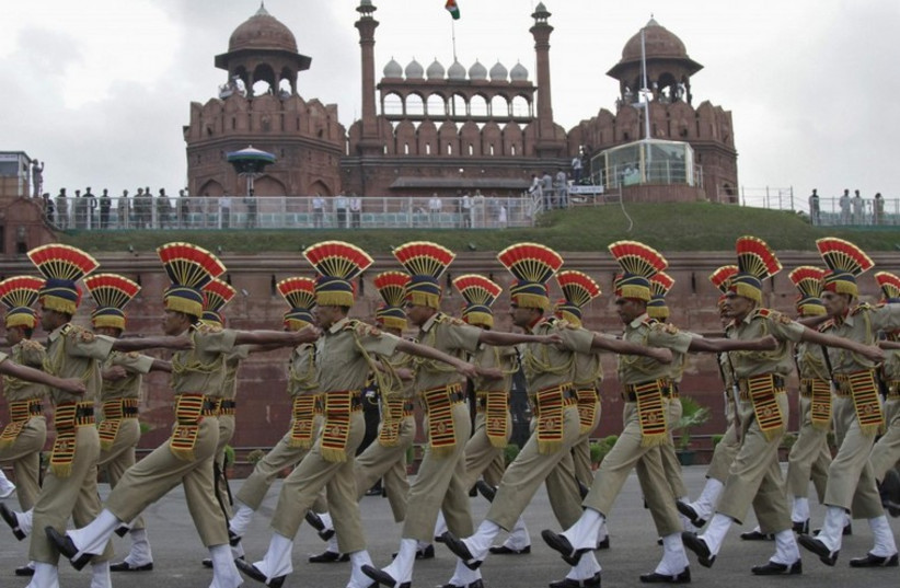 Indian soldiers march past the historic Red Fort during Independence Day celebrations in Delhi. (photo credit: REUTERS)