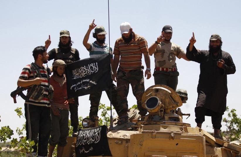 Jabhat Al-Nusra militants (photo credit: REUTERS)