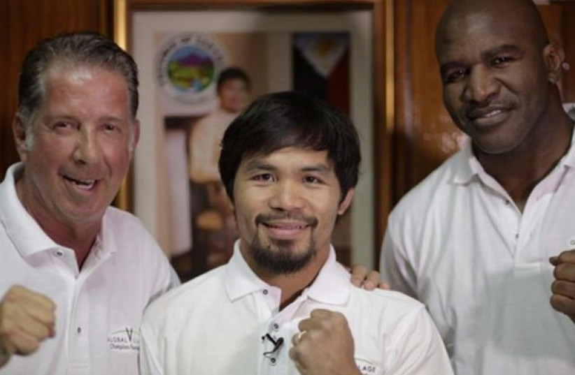 From left, Yank Barry, boxing champion Manny Pacquiao, and retired champ Evander Holyfield. (photo credit: PR)