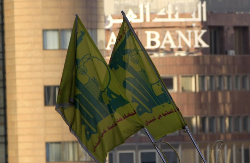 Hezbollah flags seen in front of Arab Bank building in Beirut (photo credit: REUTERS)