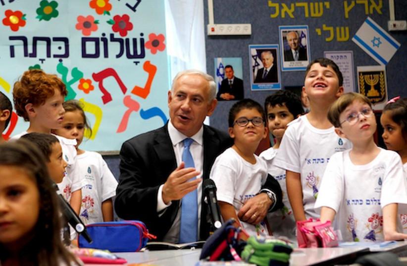 Prime Minister Binyamin Netanyahu visits schoolchildren. (photo credit: REUTERS)