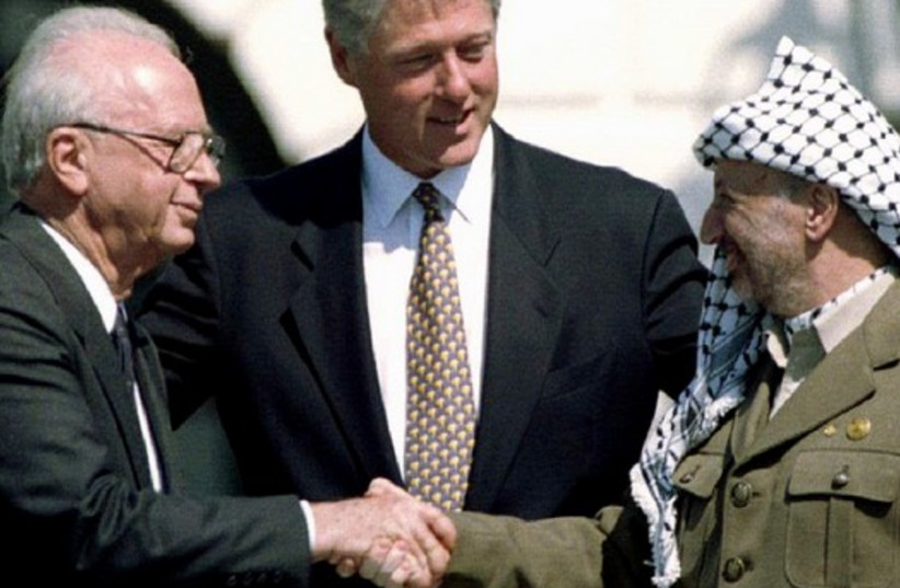Slain Israeli Prime Minister Rabin with former US President Bill Clinton and former PLO President Yasser Arafat after signing the Oslo Accords at the White House on September 13, 1993.  (photo credit: REUTERS)