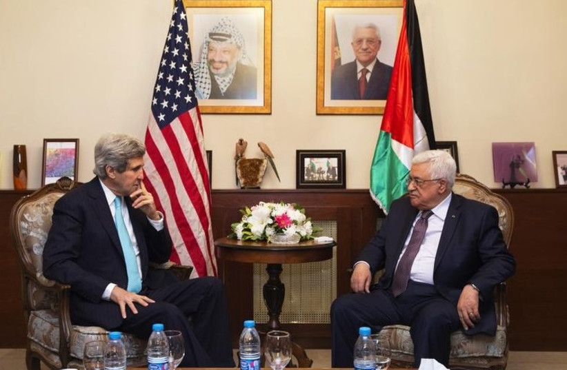 US Secretary of State John Kerry (L), meets with Palestinian Authority President Mahmoud Abbas, in Amman, Jordan March 26, 2014. (photo credit: REUTERS)