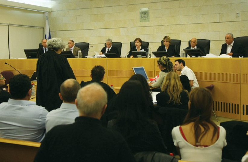 Judges preside in court (Illustrative) (photo credit: ILLUSTRATIVE: MARC ISRAEL SELLEM)