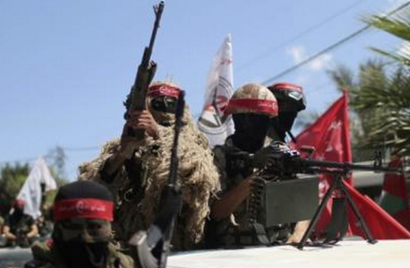 Members of the Popular Front for the Liberation of Palestinian (PFLP) take part in a military show in Gaza City September 2, 2014.  (photo credit: REUTERS)
