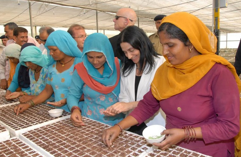 Indian farmers in Pusa working with former Israeli agriculture minister Orit Noked in 2008 (photo credit: ISRAELI EMBASSY IN NEW DELHI)