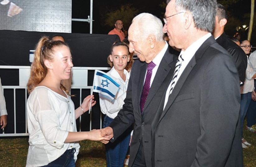 Shimon Peres and Herzliya Mayor Moshe Fadlon at the city's 90th anniversary celebrations. (photo credit: Courtesy)