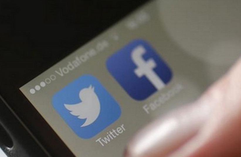 Social media apps Twitter and Facebook [Illustrative] (photo credit: REUTERS)