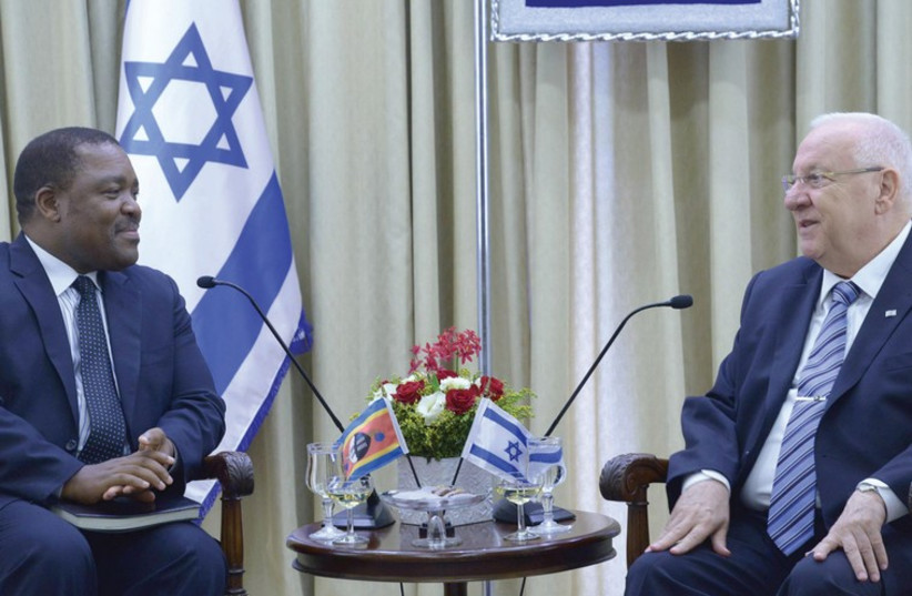PRESIDENT REUVEN RIVLIN (R) speaks with Ambassador Promise Msibi of Swaziland in the capital. (photo credit: Mark Neiman/GPO)