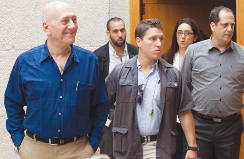 Former prime minister Ehud Olmert arrives at the Supreme Court. (photo credit: EMIL SALMAN/POOL)