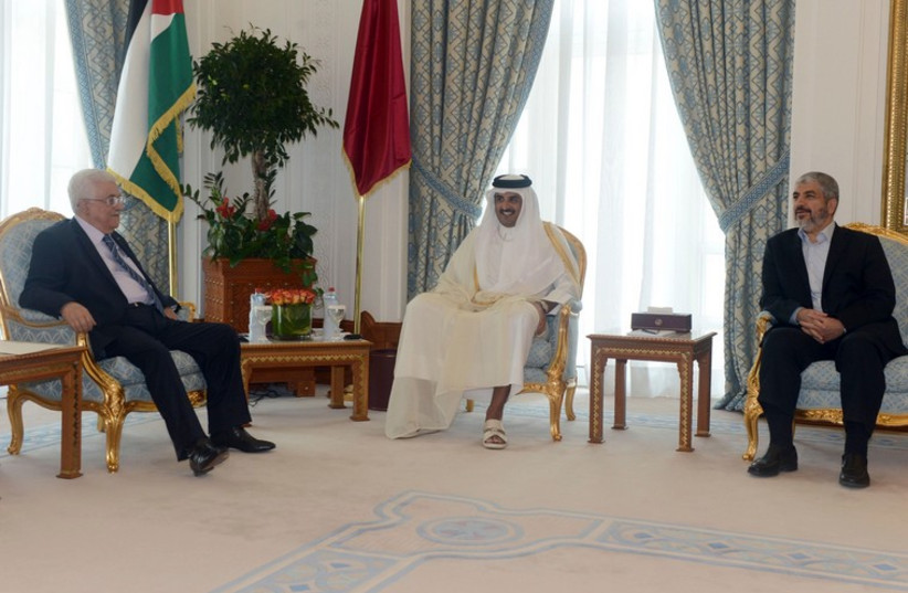 Palestinian Authority President Mahmoud Abbas, Emir of Qatar Sheikh Tamim bin Hamad al-Thani, Hamas leader Khaled Meshaal meet in Doha August 21, 2014 (photo credit: REUTERS)